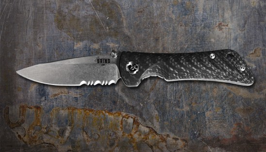 EDC knife with folding, 3.25-inch drop point serrated blade made of S35VN steel.