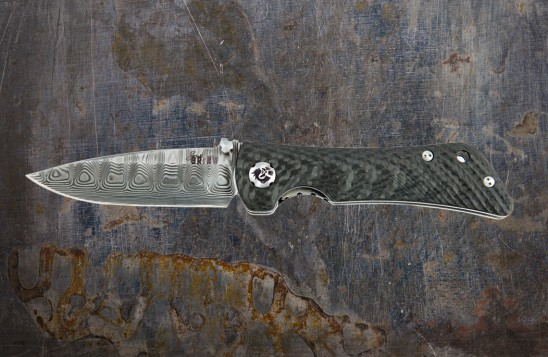 EDC knife with folding, 3.25-inch drop point blade made of Damascus steel.